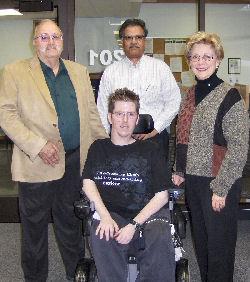 Jonathan Holman surrounded by (L-R) Clarence Hamilton, Dr. Krishna Kavi, and Patricia Hamilton.