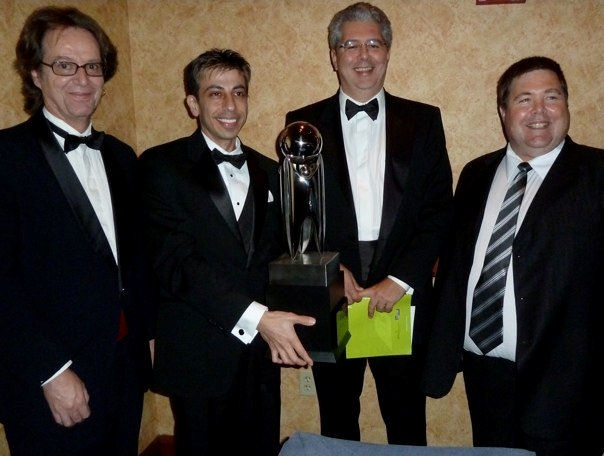 (L-R) Shown with the Tech Titan trophy are Ian Parberry, interim chair; Robert Akl, Robocamp co-director; Costas Tsatsoulis, dean of the College of Engineering; and David Keathly, Robocamp co-director.